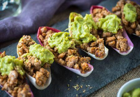 radicchio: Spicy ground turkey boats with guacamole in radicchio Stock Photo