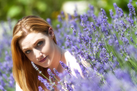 red haired: A pretty red haired girl in a field of lavender