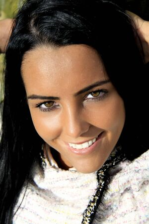 olive skin: A close up of a smiling beautiful woman