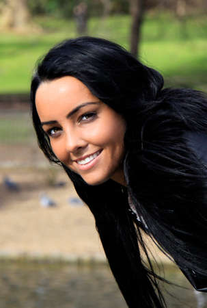olive skin: A smiling young woman with dark hair