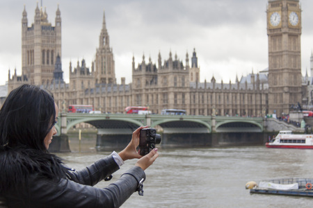 river thames: Taking a photograph across the river thames in London Stock Photo