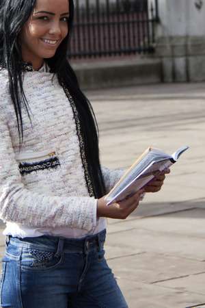 travel guide: A young woman reading a travel guide Stock Photo