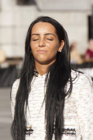 olive skin: An attarctive young woman enjoys the sun on her face