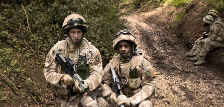 actors: Two actors playing soldiers in a film Stock Photo