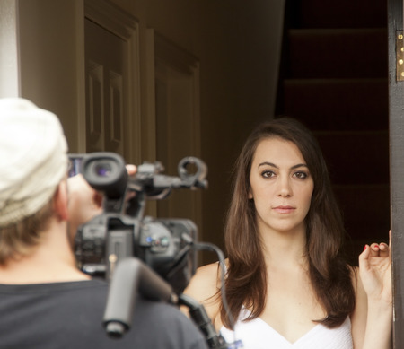 A woman being filmed