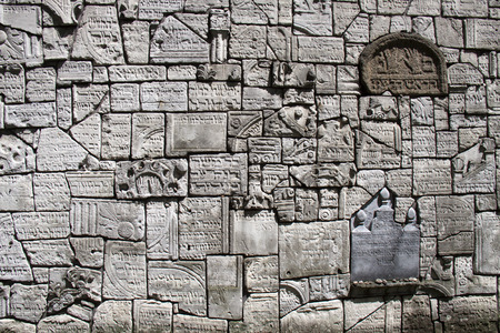 ww2: A wall with embedded tomb stones at a synagogue in Krakow. These headstones were damaged and detached during ww2 and have been preserved in this fashion as a mark of respect. Editorial