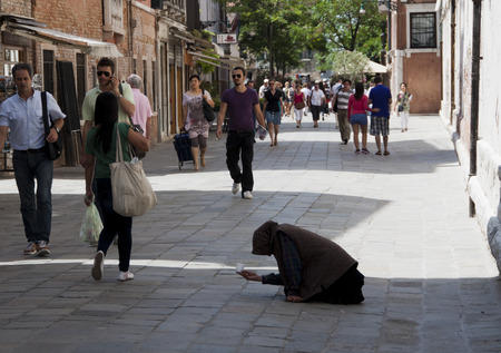 poor: Beggars in Venice - the rich and poor rub shoulders