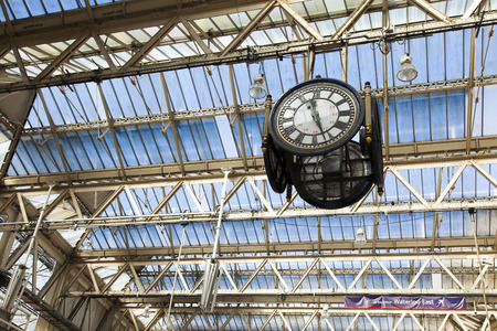 encounters: The clock at Waterloo Station under its large glass roof Editorial