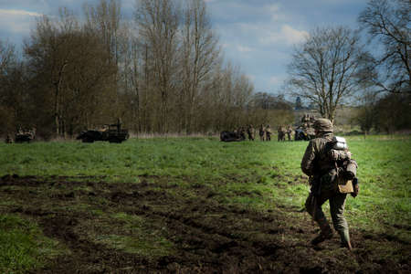 daunting: A lone german soldier walks towards the enemy in a WW2 re-enactment Editorial