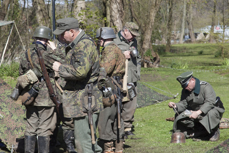 german soldiers preparing for a ww2 re-enactment Editorial