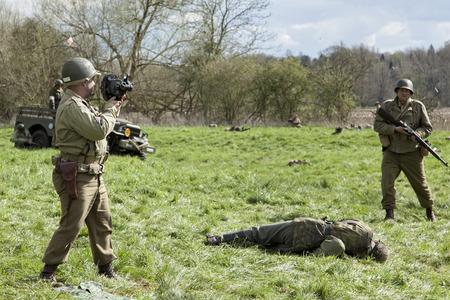 reenactment: War photographer at ww2 re-enactment battle