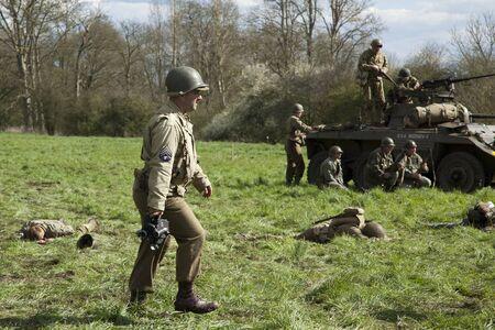 ww2: War photographer in WW2 re-enactment scene