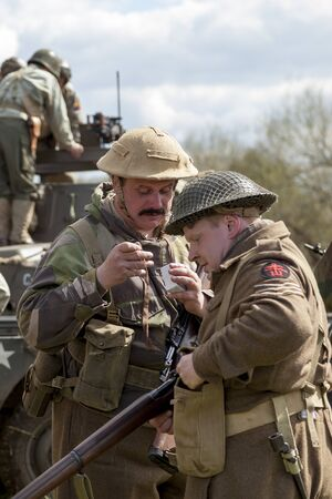 ww2: Two WW2  re-enactors have tea before the battle Editorial