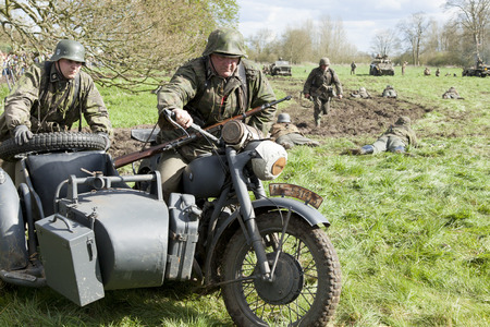 warzone: German soldier re-enactors in battle Editorial