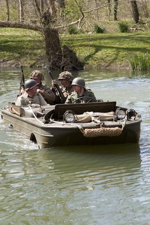 ww2: WW2 re-enactors in an amphibious craft (Duck) Editorial