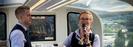 Hosts in the Rocky Mountaineer train Editorial