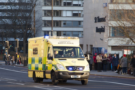London ambuland races past St Thomas Hospital, Westminster Editorial