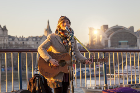 Young Female Busker in South Bank, London Editorial
