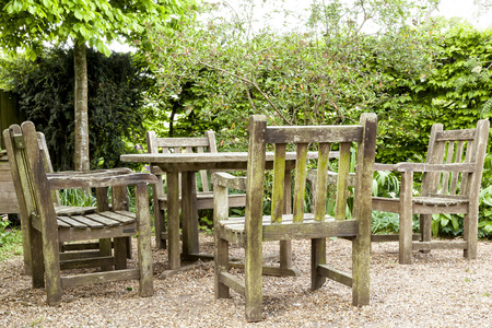 Natural wooden benches and chairs Stock Photo