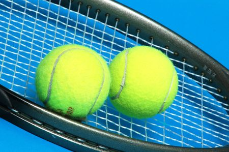 tennis racket with 2 balls