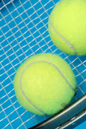 tennis racket with 2 balls