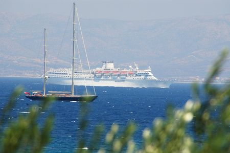 schooner: a cruise ship and a schooner in the greek islands with the island of naxos in the background