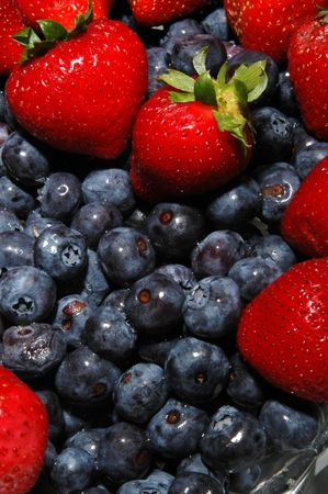 tasty fresh blueberries and strawberries close up vertical