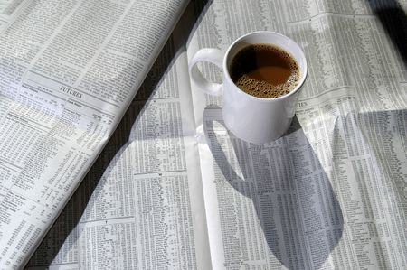 a tasty cup of coffee with the stock charts photo