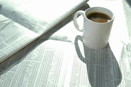 a tasty cup of coffee with the stock charts Stock Photo