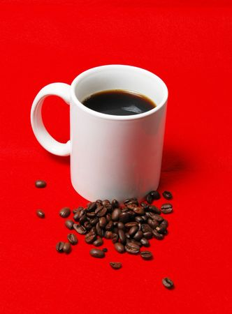 jolt: coffee cup with beans on a red background Stock Photo