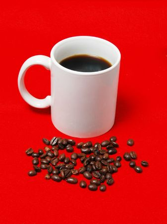 coffee cup with beans on a red background Banco de Imagens