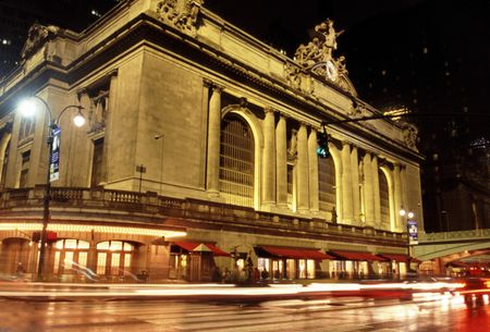 42nd: grand central terminal station at night with cars driving by