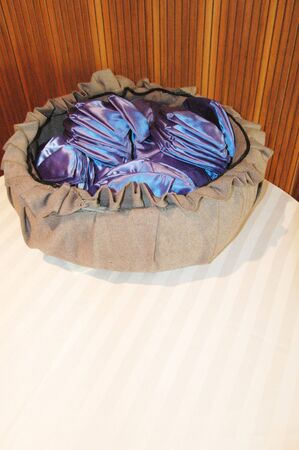 yamaka: blue yarmulkes in a basket in a temple