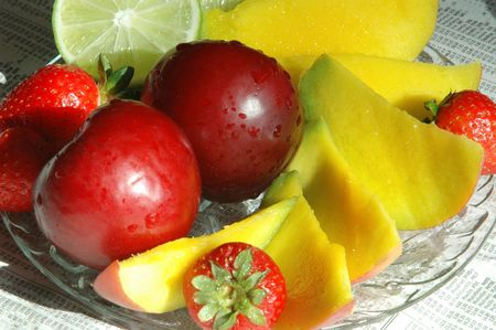 fruit platter with the morning news Stock Photo