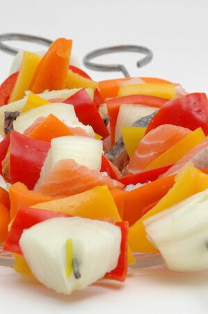 kebob: salmon kabobs with the center area intentionally in focus