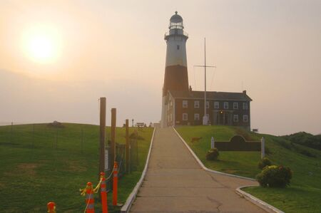 lighthouse at sunrise, deer on lawn, version 2 with name removed from sign photo