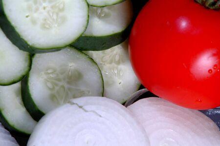 cucumbers:  sliced onions, sliced cucumbers, tomato