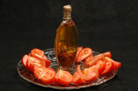 tomato platter with  olive oil in a beautiful bottle