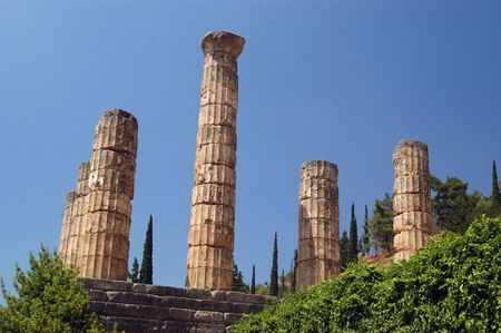 delfi: columns from the temple of apollo at ancient delphi, greece