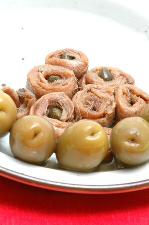 appetizing anchovies and olives close up with focus on the anchovies Stock Photo