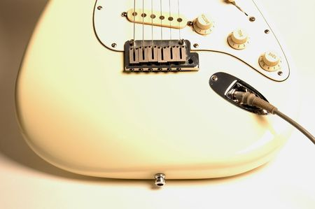 strat: detail of an electric guitar shot for high key look