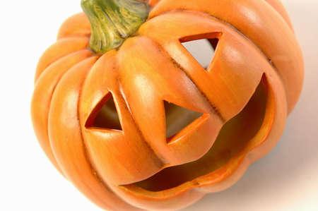 hallows': a ceramic halloween jack o lantern diagonal on white background Stock Photo