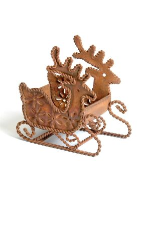 found: a unique beautiful old christmas ornament of sled pulled by reindeer mad of rusted iron found at a tag sale thrift shop Stock Photo