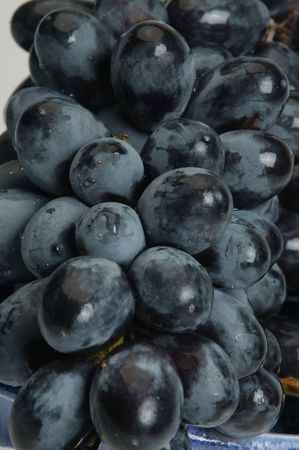 produce sections: close up of black grapes Stock Photo