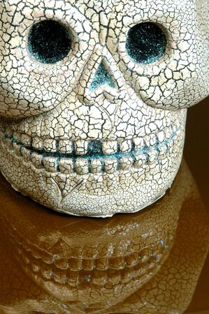 horrify: scary  ceramic halloween skull with teeth reflection