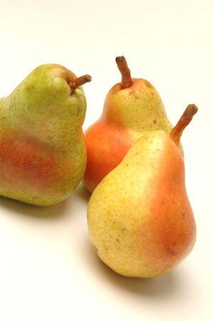 three bartlett pears on white background
