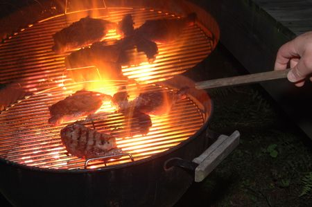 jus: grilling steaks on two kettle barbecue grills