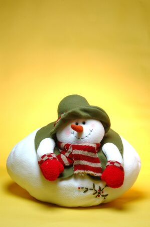 a smiling chubby snowman on a background fade yellow to orange photo