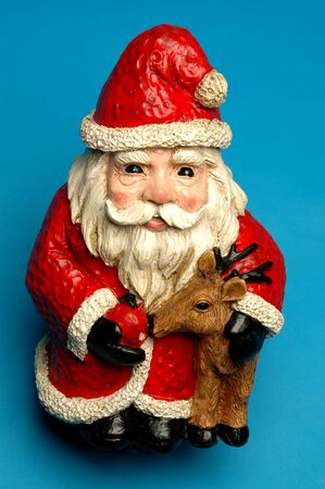 one eyed: wide eyed smiling santa claus feeding one of the reindeer