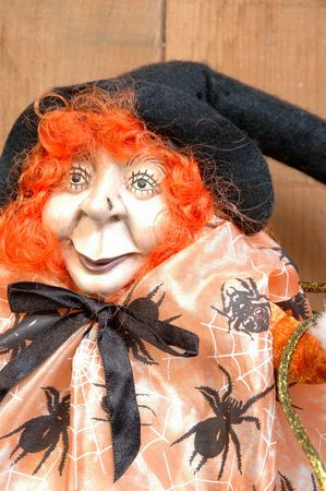 horrifying: witch with orange hair and spiders on her jacket